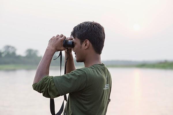 Looking through the binoculars