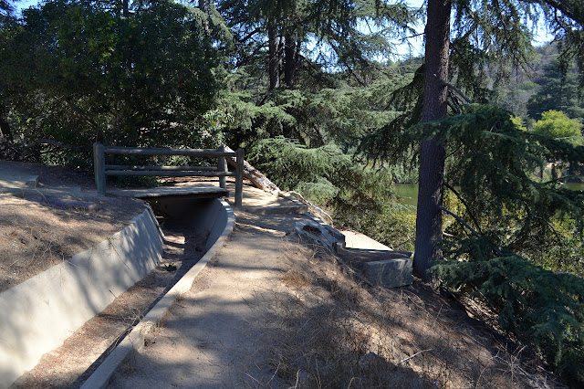 bridge over drainage to the path to the picnic tables