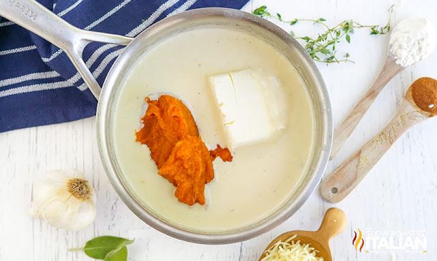 pumpkin pasta sauce ingredients in a saucepan