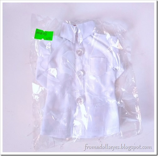 A white button down shirt for a msd or 1/4 scale ball jointed doll, bought from Alice's Collections.  It's still wrapped in plastic.