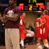 A booted Will Cherry stands at center court during halftime warm-ups.  Cherry, starting point guard for the 2012 Championship team, injured his foot a few weeks before this season's commencement and has opted to wait for natural healing (as opposed to surgery) to prevent future injury.  Dahlberg Arena in Missoula, Mont., November 14th, 2012.