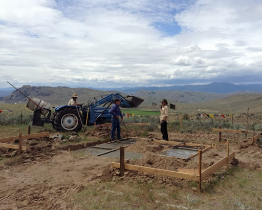 Pouring the first concrete for the stupa under the big sky of north central Washington, US, May 2013