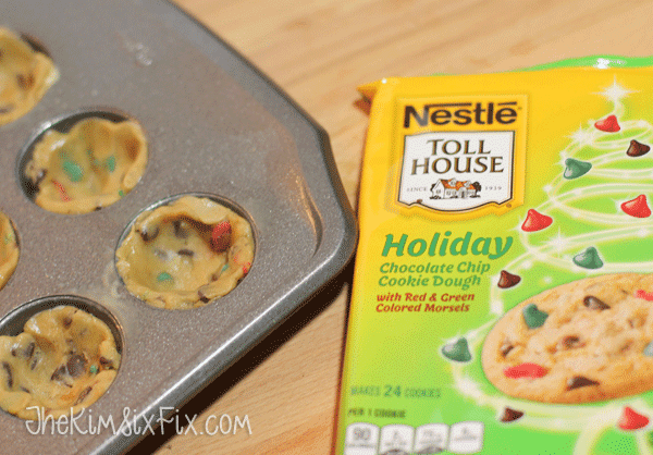 Pressing cookie dough into pan for cups