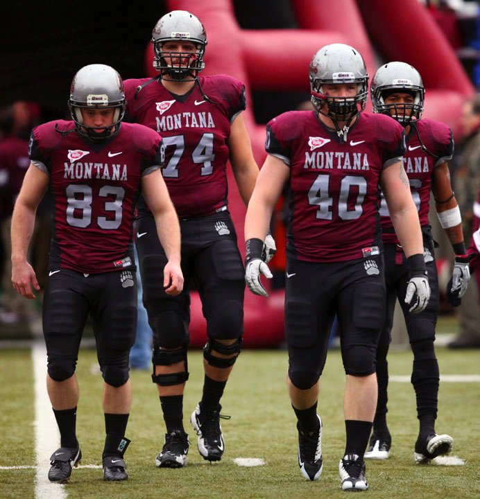 Montana Grizzlies (left to right) Brody McKnight, Jon Opperud, Caleb McSurdy, and Jabin Sambrano walk to the center of the field for the coin toss prior to the game.