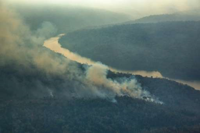 An aerial photo taken on 24 October 2015 shows forest fires in the Arariboia indigenous lands in Brazil, 'one of the biggest forest fires ever registered' within such a territory, home to 12,000 of the Guajajara people. Photo: Greenpeace
