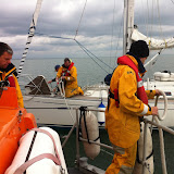 8 April 2012: Crew members onboard the casualty yacht and Tyne class lifeboat attaching the tow rope. Photo: RNLI Poole Dave Riley