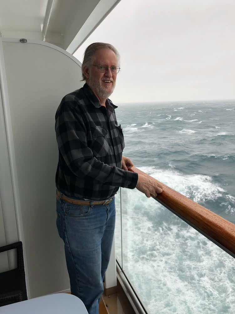 Resident Astronomer enjoying the view from stateroom veranda on the Viking Sky (Source: Palmia Observatory)