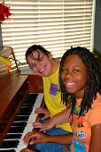 Paige & Kieshawn playing the piano