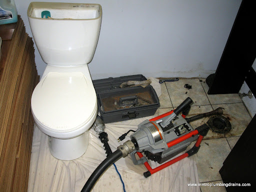 Snake Main Drain through Toilet Flange