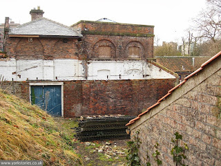 Clambering about behind the old shed, Jan 2011. Back of the engine house