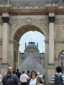 The Arc, the pyramid, the main part of The Louvre, and some random people