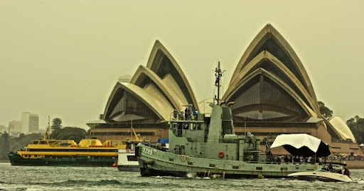 Old style tug and the Manly ferry in front of the Opera House. Celebrating Australia Day in Sydney Harbour