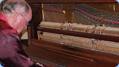 Joe Fingers giving the old piano a dusting - magic! Photo courtesy of Dennis Lyons.