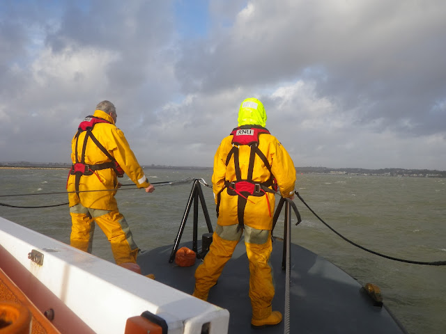 Two crew members on the ALB deck in Poole Bay. 7 January 2014.  Photo credit: Anne Millman, RNLI Poole.