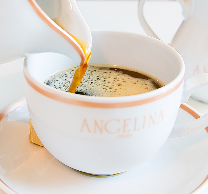 photo of coffee being poured into a mug