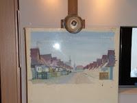 20 A festőművész befejezetlen képe szülőfaluját ábrázolja.JPG