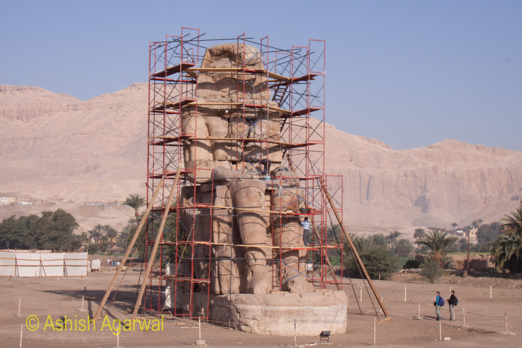 Total repair working happening on one of the statues of the Colossi of Memnon near Luxor in Egypt