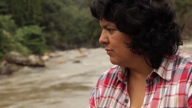 Berta Cáceres. Ms. Cáceres was murdered on 2 March 2016. She had been leading a fierce campaign against the Agua Zarca dam, a project of the Honduran company DESA, in western Honduras. The hydropower project threatened to displace thousands of people from the Lenca indigenous community. Photo: U.N. Environment / ONU Brasil / Wikimedia Commons