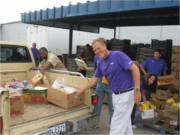 President JoAnn Reyes with volunteers