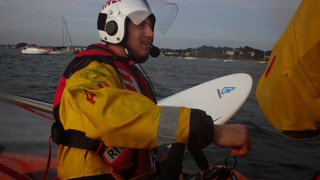 An ILB crew member secures the windsurf kit to the ILB. 28 September 2013. Photo credit: RNLI / Rob Inett