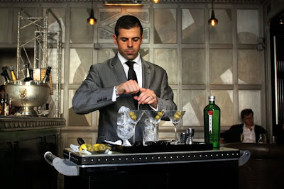 Barman mixing martinis at the Connaught Bar in London's Mayfair