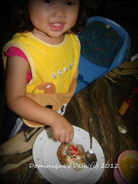 Tiger Girl digging into dinner.