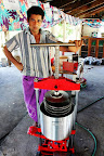 Taeia Agafili and coconut oil press in Samoa