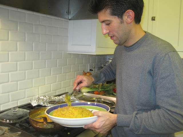 host serving up some risotto
