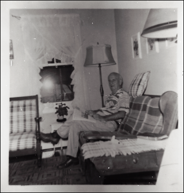 GOULD_Harry W_sitting on couch_PortHuron house_PortHuron_StClair_Michigan_enh