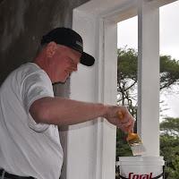 Bob Mays painting window sills.