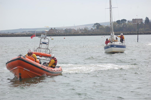 The ILB tows the now freed yacht into the main channel - 21 April 2013.  Photo credit: Dave Riley