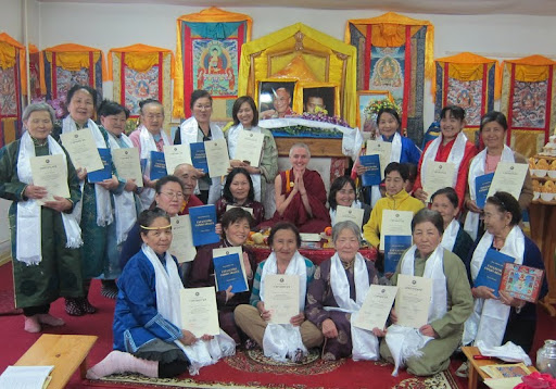 "Golden Light Sutra Center's Lam-Rim Study Group saying ""Sambhano Rinpoche!"" after receiving certificates for completing the first module of the course. They also hold copies of Pabongkha Rinpoche's ""Liberation in the Palm of Your Hand,"" Darkhan, Mongolia, May 27, 2012."