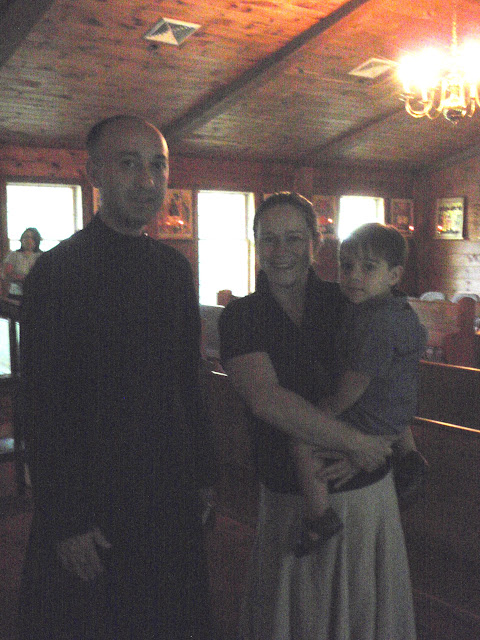 The newly-ordained Reader Lasha with our former caretaker Wendy and her son Alex.
