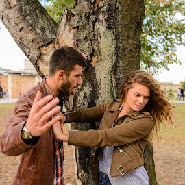 Young couple showing anger in the public park by Vera Arsic - People Couples ( young women, two people, friendship, heterosexual couple, arguing, city life, togetherness, young adult, sadness, anger, model, attractive, tree, lovers, lifestyles, girlfriend, dueling, color image, love - emotion, adult, weekend activities, photography, problems, conflict, handsome, couple - relationship, city, 20-29 years, boyfriend, casual clothing, affectionate, modern, dating, relationship difficulties, caucasian ethnicity, negative emotion, public park, nature, carefree, sexy, intimate, young men, aggression, people, young couple, outdoors, bonding, feelings, fun, fashion )