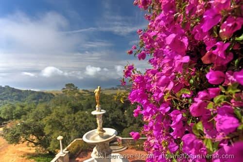 Hearst Castle golden statue California flowers