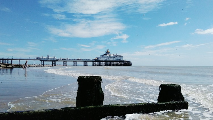 blue sky over eastbourne pier