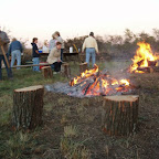 The weenie roast-- The Friday evening (Oct. 28, 2005) following the cleanup, the volunteers met to burn the brush cleaned out of the cemetery.  And what better way to cap off the group effort than with a weenie roast!  Getting the fires going and setting up.  Notice that two fires have been built.