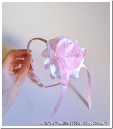 Making a flower and lace headband.  Add a ribbon bow and anyother embellishments you want, then you're done!