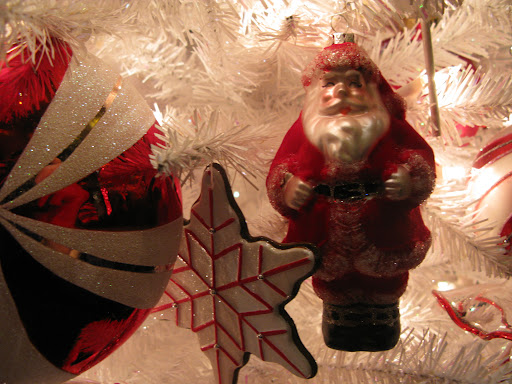 This Santa is so sweet!  All of the ornaments have glitter accents.