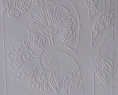 leaves and flowers drawn directly unto a blank white business card previous to cutting some parts out