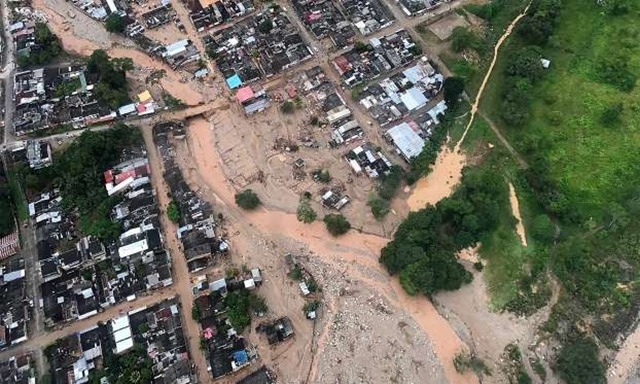 This handout photo released by the Colombia Presidential Press Office, shows an aerial view of a portion of Mocoa, Colombia, Saturday, on 1 April 2017, after an avalanche of water from an overflowing river swept through the city as people slept. The incident triggered by intense rains left at least 100 people dead in Mocoa, located near Colombia's border with Ecuador. Photo: Cesar Carrion / Colombian Presidential Press Office via AP