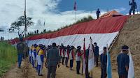 HUT RI ke-76: SMA Negeri 2 Bireuen Kibarkan Bendera 60 Meter Di Buket Teulaga Maneh