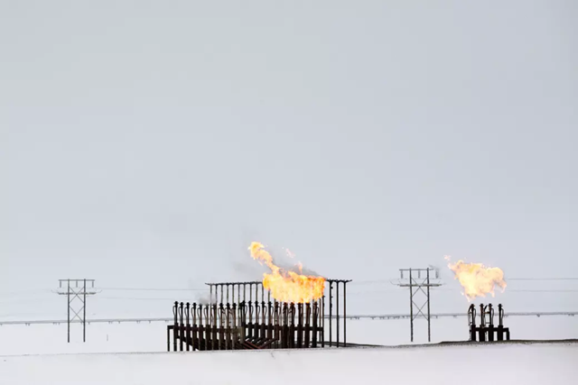 Gas flares stand outside BP's Central Gas Facility in Prudhoe Bay. Photo: Bloomberg / Getty Images