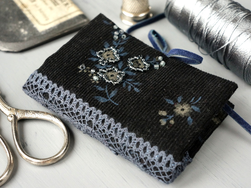 Black corduroy needle book