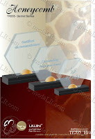 Honeycomb The Garnet series of trophies are carefully designed and elaborately finished to guarantee aesthetic proportions, elegant style and luxury appearance. They are made from acrylic sheets, (in addition to the standard crystal clear on top of piano black base, a wide selection of colours are available.) The series features a metallic base top and a metallic clip, no glue is applied to hold the body and the base together.  www.medalit.com - Absi Co