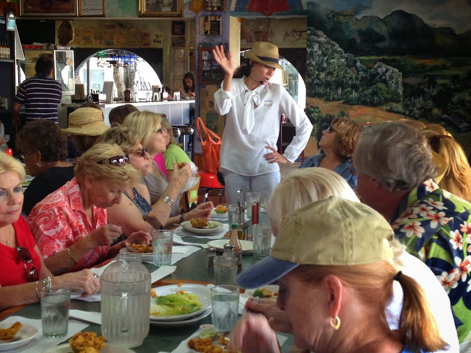 Participants in Miami Culinary Tours' Little Havana tours chow down on Cuban food. Photo from Miami Culinary Tours