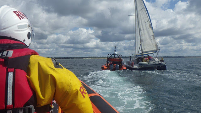 Poole ILB stands by as Mudeford ILB assists a catamaran that was taking on water - 25 July 2015