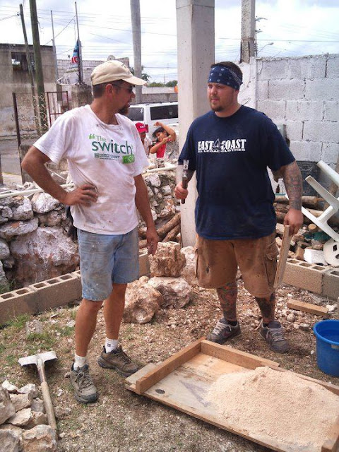 Bruce and Joel talking about the finer points of mixing cement.