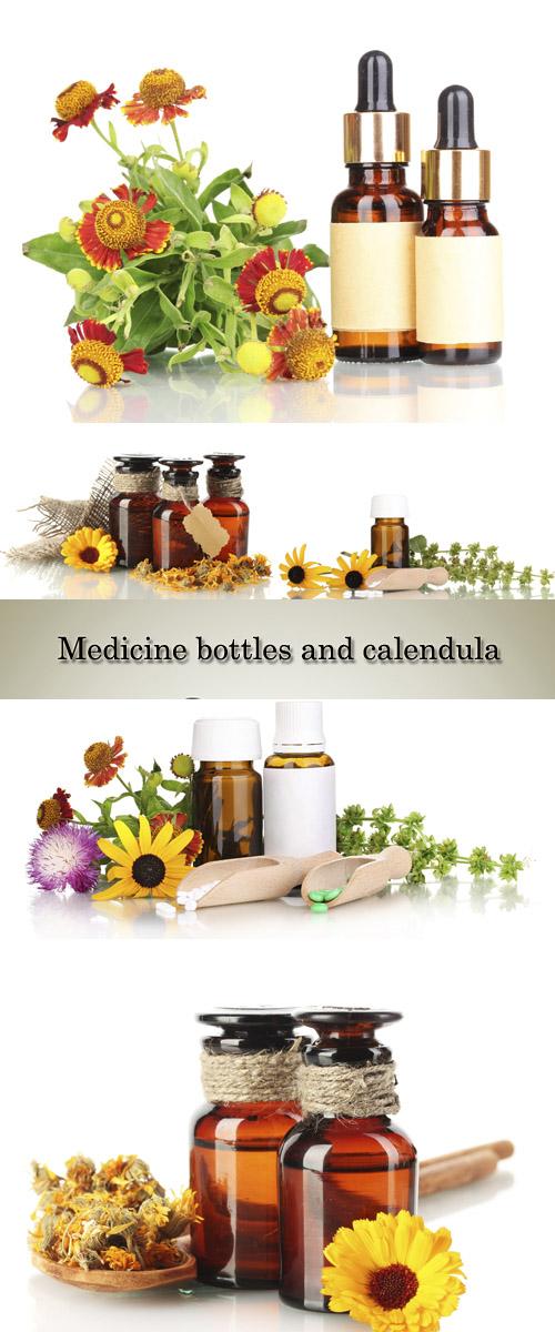 Stock Photo: Medicine bottles and calendula, isolated on white