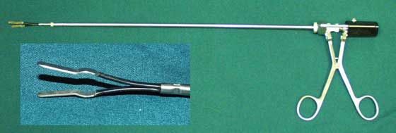 Photograph of bipolar surgical instrument. Inset shows close up of electrodes.